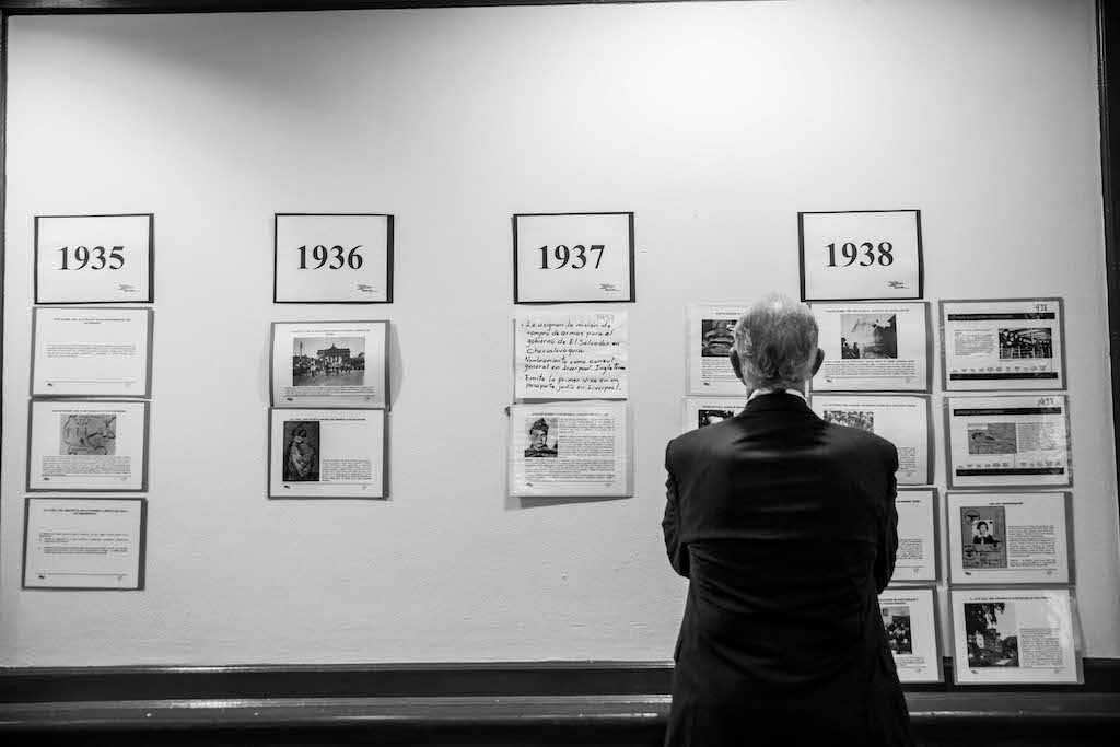 Holocaust education, man looks at posters