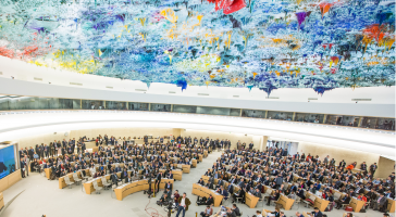 A wide view of the Human Rights and Alliance of Civilizations Room at the Palais des Nations during the high-level segment of the Human Right Council's thirty-fourth regular session.